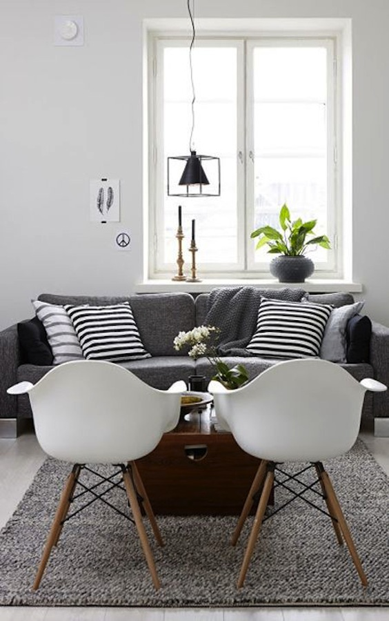grey-sofa-and-white-eames-chairs